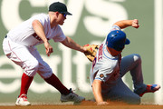 Jay Bruce #19 of the New York Mets is tagged out while trying to steal second base by Brock Holt #12 of the Boston Red Sox in the second dining of a game at Fenway Park on September 16, 2018 in Boston, Massachusetts.