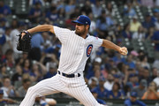 Cole Hamels #35 of the Chicago Cubs pitches against the New York Mets during the first inning on August 28, 2018 at Wrigley Field  in Chicago, Illinois.