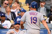 Mickey Callaway #36 of the New York Mets reacts to the run of Jay Bruce #19, from a Jacob deGrom #48 single, to tie the Los Angeles Dodgers 1-1 during the fifth inning at Dodger Stadium on September 3, 2018 in Los Angeles, California.