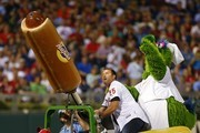 Former Philadelphia Phillies Jim Thome, shoots hot dogs into the crowd with the help of the the Phillie Phanatic, during a game at Citizens Bank Park on August 9, 2014 in Philadelphia, Pennsylvania. The Mets defeated the Phillies 2-1 in 11 innings.