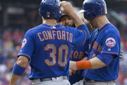 Michael Conforto #30 of the New York Mets celebrates with Jose Bautista #11 and Todd Frazier #21 after a grand slam by Bautista in the top of the fifth inning against the Philadelphia Phillies in game one of the doubleheader at Citizens Bank Park on August 16, 2018 in Philadelphia, Pennsylvania. The Mets defeated the Phillies 24-4.