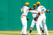 Starling Marte #6, Andrew McCutchen #22, and Gregory Polanco #25 of the Pittsburgh Pirates celebrate their 9-1 win against the New York Mets during the game at PNC Park on May 24, 2015 in Pittsburgh, Pennsylvania.