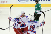 Kevin Klein #8 of the New York Rangers celebrates with Ryan McDonagh #27 of the New York Rangers and Jesper Fast #19 of the New York Rangers after scoring the game-winning goal against the Dallas Stars in the third period at American Airlines Center on February 27, 2016 in Dallas, Texas.