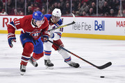 Brendan Gallagher #11 of the Montreal Canadiens skates the puck against Marc Staal #18 of the New York Rangers during the NHL game at the Bell Centre on February 22, 2018 in Montreal, Quebec, Canada.