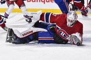 Goaltender Antti Niemi #37 of the Montreal Canadiens falls to the ice to make a glove save in the first period against the New York Rangers during the NHL game at the Bell Centre on February 22, 2018 in Montreal, Quebec, Canada.  The Montreal Canadiens defeated the New York Rangers 3-1.