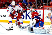 Carl Hagelin #62 of the New York Rangers and Andrei Markov #79 of the Montreal Canadiens battle for the puck in front of the net  during Game Five of the Eastern Conference Final in the 2014 NHL Stanley Cup Playoffs at Bell Centre on May 27, 2014 in Montreal, Canada.