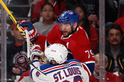 Martin St. Louis #26 of the New York Rangers checks Andrei Markov #79 of the Montreal Canadiens during the first period in Game Two of the Eastern Conference Final during the 2014 Stanley Cup Playoffs at Bell Centre on May 19, 2014 in Montreal, Canada.