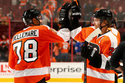 Pierre-Edouard Bellemare #78 and Claude Giroux #28 of the Philadelphia Flyers celebrate the win over the New York Rangers on September 30, 2014 at the Wells Fargo Center in Philadelphia, Pennsylvania.The Philadelphia Flyers defeated the New York Rangers 4-2.
