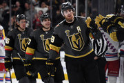 James Neal (R) #18 of the Vegas Golden Knights, followed by teammates David Perron #57 and Erik Haula #56, celebrates with teammates on the bench after scoring against the New York Rangers in the first period of their game at T-Mobile Arena on January 7, 2018 in Las Vegas, Nevada.