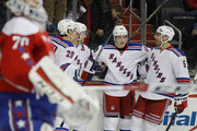 (l-r) Chris Kreider #20, Derek Stepan #21, Jesper Fast #19 and Dan Girardi #5 of the New York Rangers celebrate Stephan's game winning goal at 17 seconds of the third period against the New York Rangers at the Verizon Center on March 4, 2016 in Washington, DC. The Rangers defeated the Capitals 3-2.