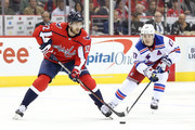 Evgeny Kuznetsov #92 of the Washington Capitals and Jesper Fast #17 of the New York Rangers go after the puck during the second period at Capital One Arena on October 17, 2018 in Washington, DC.