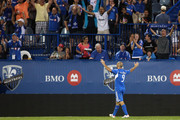 Marco Di Vaio #9 of the Montreal Impact celebrates his first goal as a member of the Montreal Impact during the match against the New York Red Bulls at the Saputo Stadium on July 28, 2012 in Montreal, Quebec, Canada.  The Impact defeated the Red Bulls 3-1.