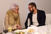 Iris Apfel (L) and guest attend the Speaker Dinner presented by Mercedes-Benz during The New York Times International Luxury Conference at the Moore Building on December 1, 2014 in Miami, Florida.