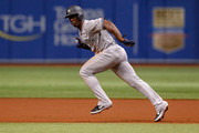 Andrew McCutchen #26 of the New York Yankees takes off from first base in the first inning of a baseball game against the Tampa Bay Rays at Tropicana Field on September 26, 2018 in St. Petersburg, Florida.