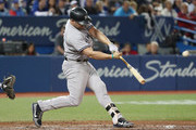 Matt Holliday #17 of the New York Yankees hits an RBI double in the fourth inning during MLB game action against the Toronto Blue Jays at Rogers Centre on June 4, 2017 in Toronto, Canada.