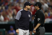 Manager Aaron Boone of the New York Yankees argues with homeplate umpire Pat Hoberg #31 after he was ejected from the game against the Texas Rangers at Globe Life Park in Arlington on May 22, 2018 in Arlington, Texas.