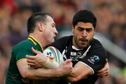 Jesse Bromwich (C) of New Zealand is tackled by Paul Gallen (L) and Cameron Smith of Australia during the Rugby League World Cup final between New Zealand and Australia at Old Trafford on November 30, 2013 in Manchester, England.