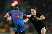 Maxime Medard of France puts a fend on Ben Smith of the All Blacks during the International Test match between the New Zealand All Blacks and France at Westpac Stadium on June 16, 2018 in Wellington, New Zealand.