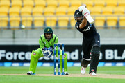 Grant Elliott of New Zealand bats while Sarfraz Ahmed of Pakistan looks on during the One Day International match between New Zealand and Pakistan at Westpac Stadium on January 31, 2015 in Wellington, New Zealand.