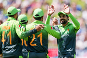 Mohammad Nawaz of Pakistan celebrates with Shoaib Malik after taking the wicket of Colin Munro of New Zealand during game five of the One Day International Series between New Zealand and Pakistan at Basin Reserve on January 19, 2018 in Wellington, New Zealand.