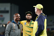 Imran Tahir of South Africa celebrates with team staffs after winning the first International Twenty20 match between New Zealand and South Africa at Eden Park on February 17, 2017 in Auckland, New Zealand.