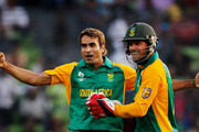 Imran Tahir of South Africa celebrates with teammate AB de Villiers after taking the wicket of Jesse Ryder of New Zealand during the 2011 ICC World Cup Quarter-Final match between New Zealand and South Africa at Shere-e-Bangla National Stadium on March 25, 2011 in Dhaka, Bangladesh.