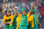 Imran Tahir of South Africa celebrates with team mates after claiming the wicket of Jesse Ryder of New Zealand during the 2011 ICC World Cup Quarter-Final match between New Zealand and South Africa at Shere-e-Bangla National Stadium on March 25, 2011 in Dhaka, Bangladesh.