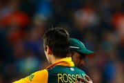 Imran Tahir of South Africa hugs Rilee Rossouw (L)  following the 2015 Cricket World Cup Semi Final match between New Zealand and South Africa at Eden Park on March 24, 2015 in Auckland, New Zealand.