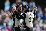 Grant Elliott of the Black Caps celebrates the run out of Chamara Kapugedera of Sri Lanka with Martin Guptill of the Black Caps during the Twenty20 match between New Zealand and Sri Lanka at Bay Oval on January 7, 2016 in Mount Maunganui, New Zealand.