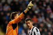 Hatem Ben Arfa of Newcastle and goalkeeper David Marshall of Cardiff  clash during the Budweiser FA Cup third round match between Newcastle United and Cardiff City at St James' Park on January 4, 2014 in Newcastle upon Tyne, England.