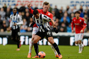 Hatem Ben Arfa of Newcastle is tackled Aron Gunnarsson of Cardiff during the Budweiser FA Cup third round match between Newcastle United and Cardiff City at St James' Park on January 4, 2014 in Newcastle upon Tyne, England.