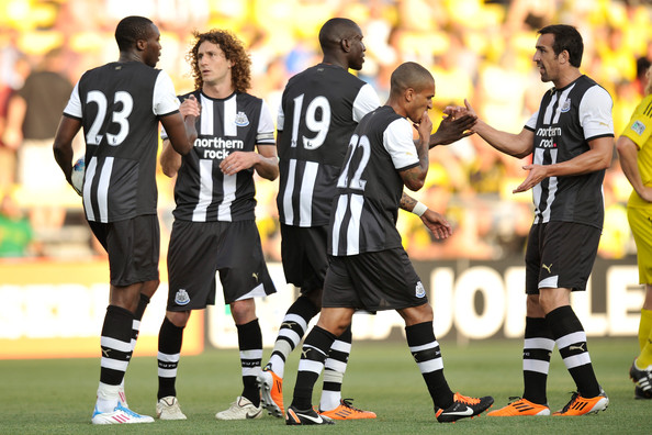Fabricio Coloccini #2 of Newcastle United FC celebrates with teammate Shola Ameobi #23 after Ameobi's first-half goal against the Columbus Crew on July 26, 2011 at Crew Stadium in Columbus, Ohio.