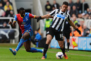 Yannick Bolasie of Crystal Palace challenges Hatem Ben Arfa of Newcastle United during the Barclays Premier League match between Newcastle United and Crystal Palace at St James' Park on March 22, 2014 in Newcastle upon Tyne, England.