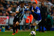 Hatem Ben Arfa of Newcastle United and Ross Barkley of Everton battle for the ball during the Barclays Premier League match between Newcastle United and Everton at St James' Park on March 25, 2014 in Newcastle upon Tyne, England.