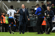 Goalscorer Vurnon Anita of Newcastle United is congratulated by Rafael Benitez the manager of Newcastle United following the final whistle during the Barclays Premier League match between Newcastle United and Manchester City at St James' Park on April 19, 2016 in Newcastle, England.