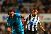 Etienne Capoue of Tottenham Hotspur and Hatem Ben Arfa of Newcastle United battle for the ball during the Barclays Premier League match between  Newcastle United and Tottenham Hotspur at St James' Park on February 12, 2014 in Newcastle upon Tyne, England.