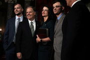 U.S. Sen. Doug Jones (D-AL) (2nd L) participates in a group photo with (L-R) son Carson, wife Louise, and son Christopher after a mock swearing-in ceremony at the Old Senate Chamber of the U.S. Capitol January 3, 2018 in Washington, DC. Jones is the first Democratic senator from Alabama in more than two decades. He defeated Roy Moore leaving Republicans with a 51-49 majority in the U.S. Senate.
