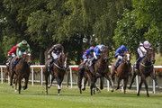 Ryan Moore riding Aces (L, brown) win The 188Bet Mobile Bet10 Get20 Handicap Stakes at Newmarket Racecourse on June 28, 2018 in Newmarket, United Kingdom.