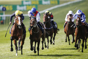 Paul Hanagan riding Porth Swtan (L) win The Alex Scott Maiden Stakes (div II) at Newmarket racecourse on April 17, 2018 in Newmarket, England.