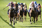 Ryan Moore riding Just Wonderful (L) win The Shadwell Rockfel Stakes at Newmarket Racecourse on September 28, 2018 in Newmarket, United Kingdom.