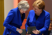 (L-R) British Prime Minister Theresa May and German Chancellor Angela Merkel share a joke at a round table meeting on April 10, 2019 in Brussels, Belgium.Theresa May formally presents her case to the European Union for a short delay to Brexit until 30 June 2019. The other EU leaders will then then discuss how to respond at a dinner without her.