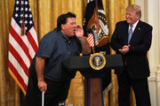 "U.S.  Bruce Hrobak (L), owner of Billy Bones Bait & Tackle in Port St. Lucie, Florida, speaks as President Donald Trump (R) looks on during an East Room event on the environment July 7, 2019 at the White House in Washington, DC. President Trump delivered remarks on ""his Administration's environmental accomplishments of cleaner air and cleaner water, including helping communities across the Nation reduce air pollution and meet our air quality standards, as well as modernize outdated infrastructure and improve water quality while at the same time growing a strong economy for all Americans."""
