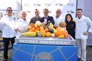 """(Left to right)  """"Next Iron Chef"""" cast chef Robert Irvine, chef Anne Burrell, season 3 winner Marc Forgione, host Alton Brown, chef Geoffrey Zakarian, chef Alex Guarnaschelli, and chef Michael Chiarello attend the """"Next Iron Chef"""" interactive experience kick-off on the  Streets of Manhattan on September 30, 2011 in New York City."""