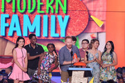 (L-R) Actress Kathrine Herzer, actor Chris Rock, Lola Simone Rock, actor Jesse Tyler Ferguson, actor Nolan Gould (obscured), actor Rico Rodriguez, actress Sarah Hyland and actress Ariel Winter speak onstage during Nickelodeon's 28th Annual Kids' Choice Awards held at The Forum on March 28, 2015 in Inglewood, California.