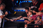 (From 2nd L) Swimmer Michael Phelps, Boomer Robert Phelps, Nicole Johnson, and Beckett Richard Phelps attend the Nickelodeon Kids' Choice Sports 2018 at Barker Hangar on July 19, 2018 in Santa Monica, California.