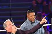 (L-R) Bruce Buffer and host Michael Strahan speak onstage during Nickelodeon Kids' Choice Sports 2019 at Barker Hangar on July 11, 2019 in Santa Monica, California.