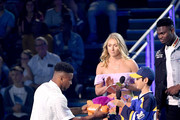 (L-R) Saquon Barkley accepts the Favorite Breakout Player award onstage from Mikaela Shiffrin and Zion Williamson during Nickelodeon Kids' Choice Sports 2019 at Barker Hangar on July 11, 2019 in Santa Monica, California.