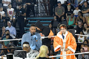 (L-R) Kel Mitchell, host Michael Strahan, Lindsey Vonn, and David Dobrik participate in a challenge onstage during Nickelodeon Kids' Choice Sports 2019 at Barker Hangar on July 11, 2019 in Santa Monica, California.