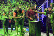 (L-R) Rob Gronkowski, Michael Strahan, and Kel Mitchell get slimed onstage during Nickelodeon Kids' Choice Sports 2019 at Barker Hangar on July 11, 2019 in Santa Monica, California.
