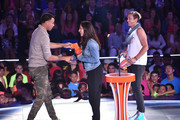 (L-R) NBA player Stephen Curry accepts the Sickest Moves award from U.S. Women's Soccer players Alex Morgan and Abby Wambach onstage at the Nickelodeon Kids' Choice Sports Awards 2015 at UCLA's Pauley Pavilion on July 16, 2015 in Westwood, California.